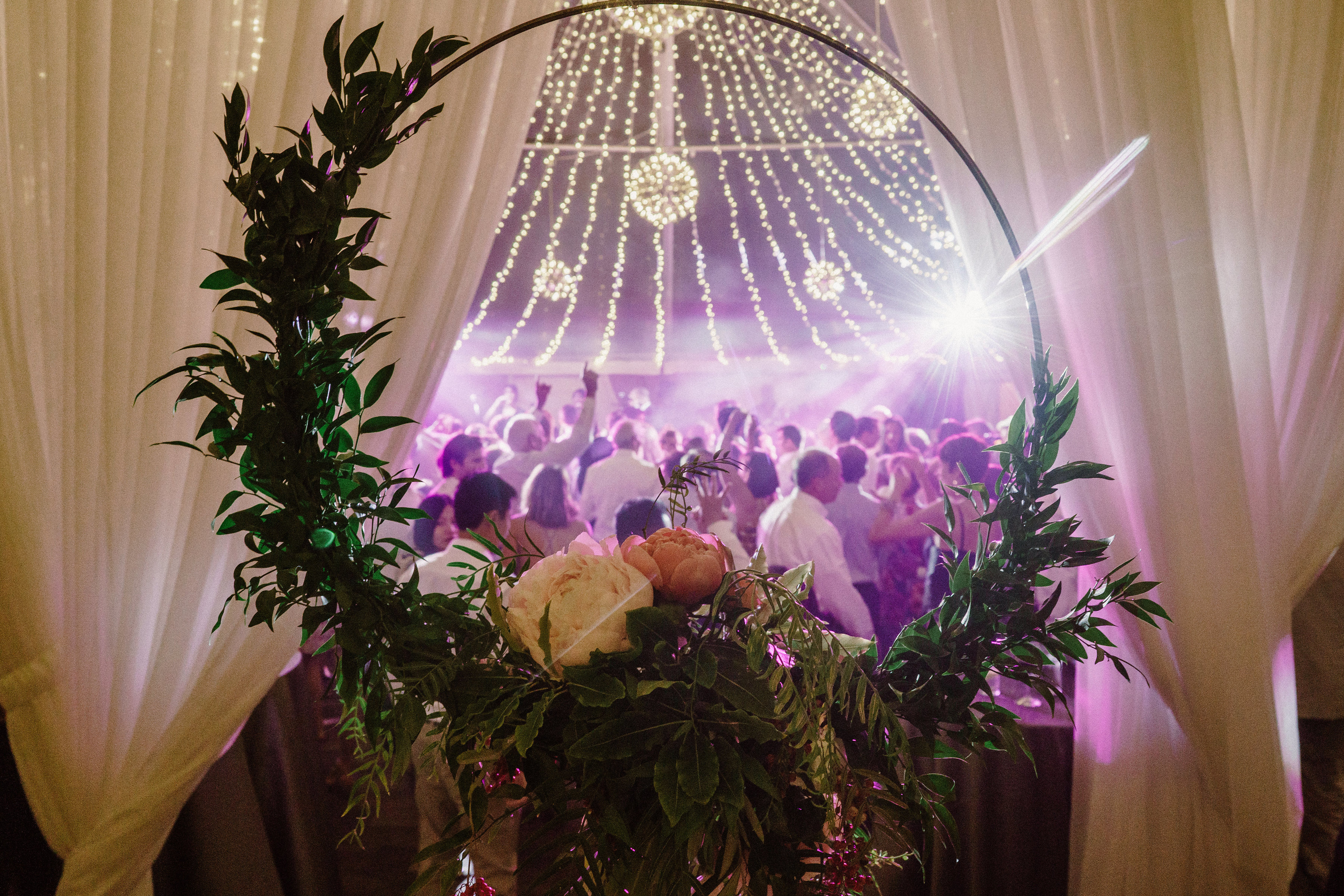 A Starry Night in New England Luxury Wedding floral hoop and lighting design