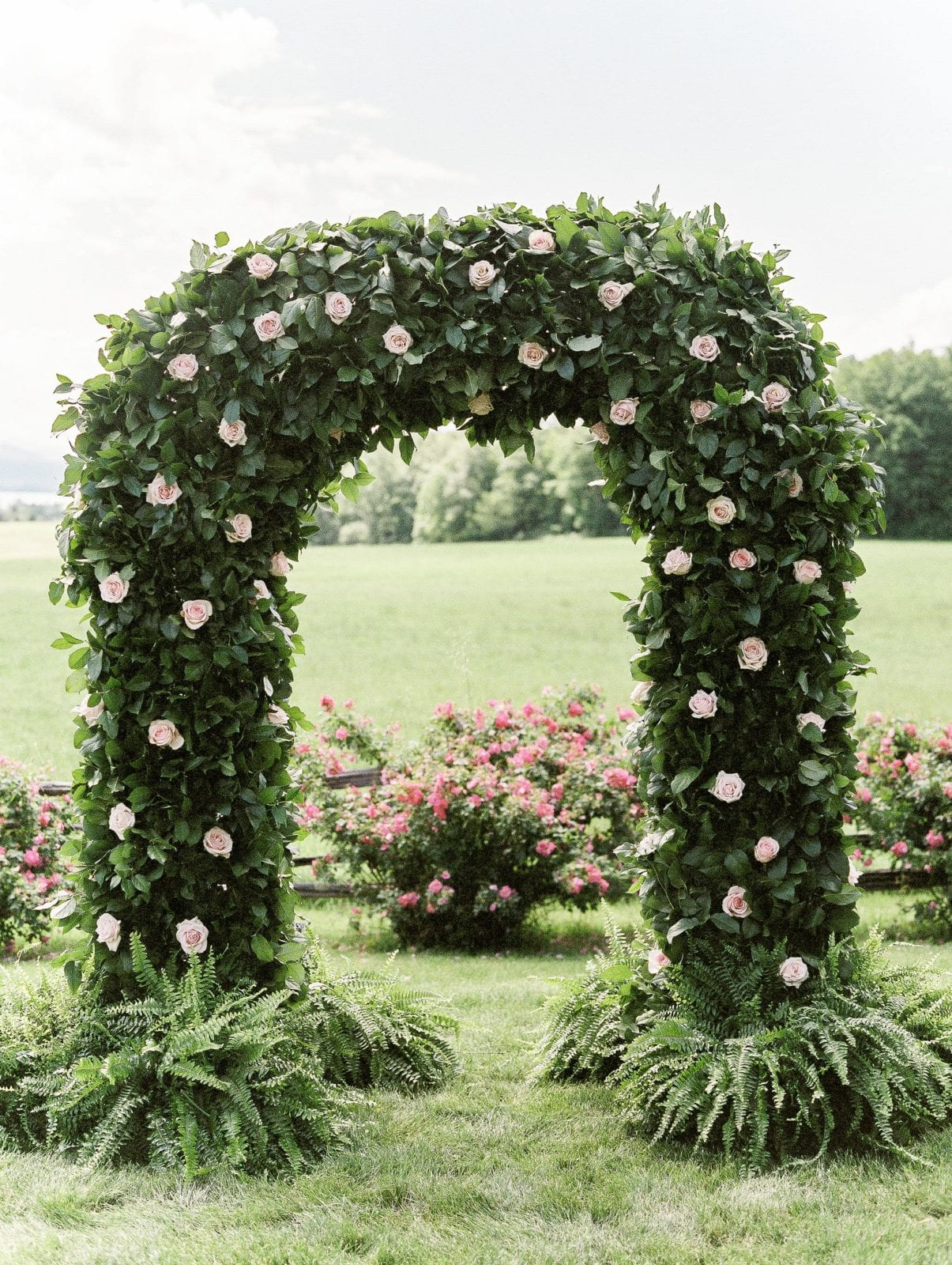 Glistening chandlers by Jaclyn Watson Events new England Wedding Rose floral Arbor