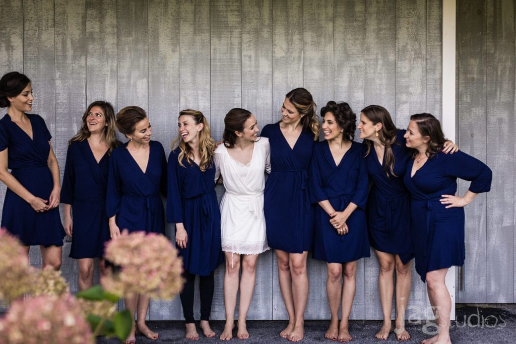 A Bride with her bridesmaids wearing blue robes