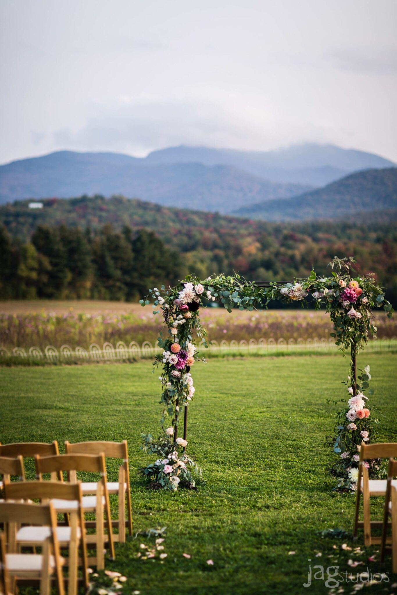 Lush floral arbor Mountain Views luxury wedding