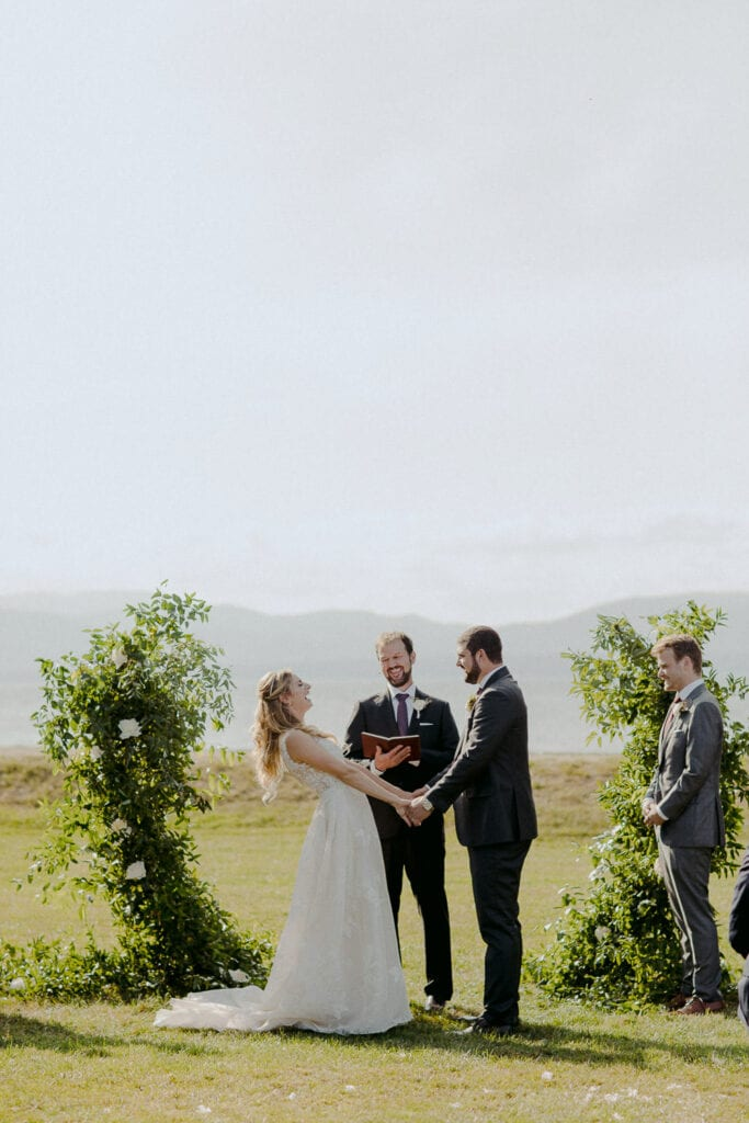 Jaclyn Watson Events • Modern Lakefront Wedding• asymmetrical green arbor