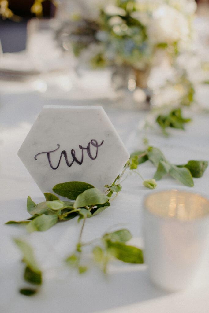Jaclyn Watson Events • Modern Lakefront Wedding• Marble tabletop numbers