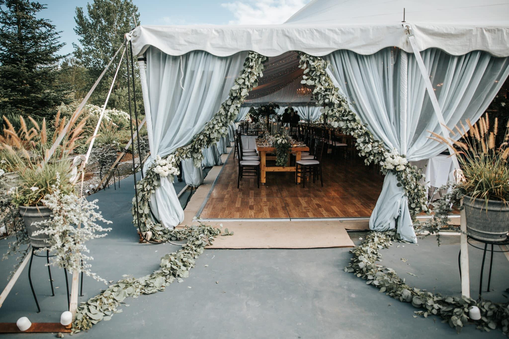 Jaclyn Watson Events • blue chiffon tent draping entrance •New England wedding planner