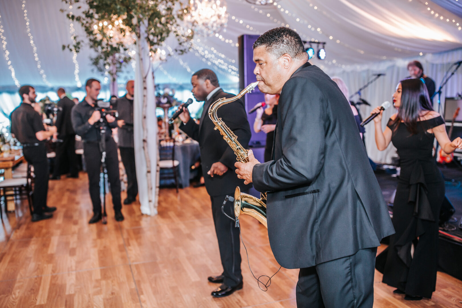 Man playing saxophone in wedding band
